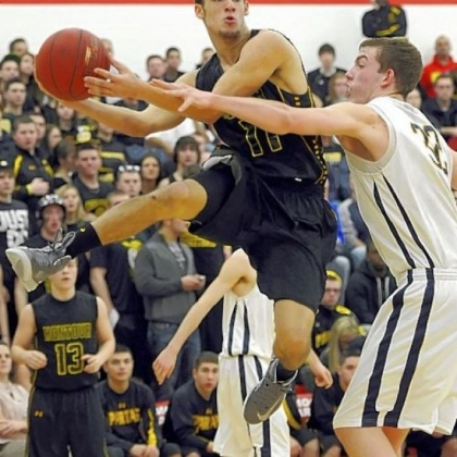 Montour's Devin Wilson, left, looks to slide a pass around Mars' Josh Goetz in a Class AAA semifinal Tuesday at Moon.