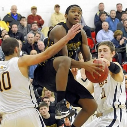Montour's Justin Hill drives to the basket against Mars' Owen Nearhoof and Matt Getsy Tuesday in a Class AAA semifinal. Montour defeated Mars, 61-52.