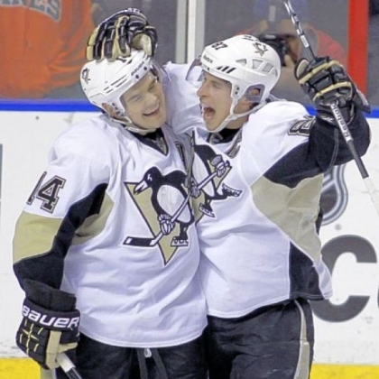 When Chris Kunitz, left, scored on a power play in the final minute of the second period to tie the score, 4-4, momentum seemed to be on the side of the Penguins. But it would be their final goal of the game. He celebrates with Sidney Crosby.