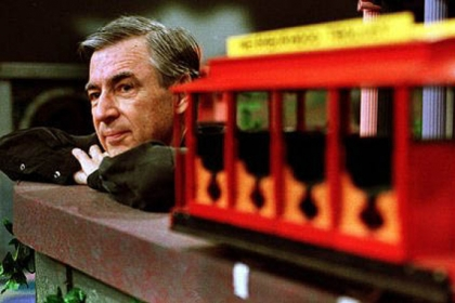 "Fred Rogers pauses during a taping of his show ""Mister Rogers' Neighborhood."""