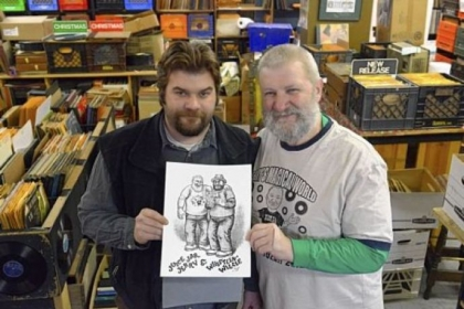 Jerry Weber and his son, Willie, left, of Jerry's Records in Squirrel Hill, with a drawing of them by Robert Crumb. The Webers plan to sell T-shirts featuring the drawing in the early spring.