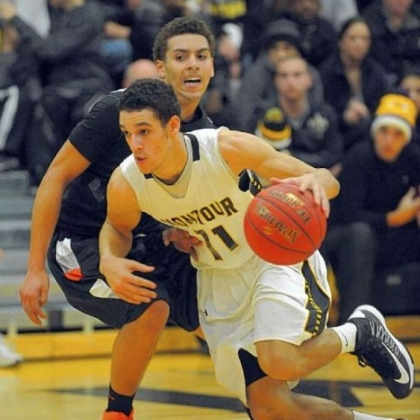 Senior guard Devin Wilson, driving around Beaver Falls&#039; Elijah Cottrill during a game earlier this season, has led Montour by example this season.
