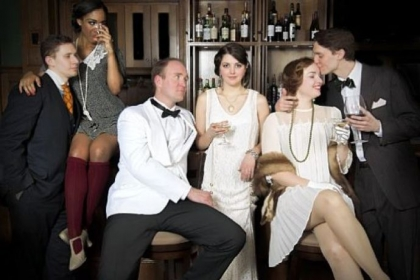 "Ryan Kearney, left, portrays Tom Buchanan, Alexis Cash is Myrtle Wilson, Sean Patrick Sears is Jay Gatsby, Julia Warner is Daisy Buchanan, Katie Oxman is Jordan Baker and Andrew Swackhamer is Nick Carraway in Prime Stage Theater's production of ""The Great Gatsby,"" based on F. Scott Fitzgerald's book."