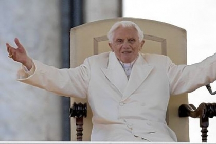"Pope Benedict XVI opens his arms during his final general audience Wednesday in St. Peter's Square at  the Vatican. Pope Benedict basked in an emotional send-off, recalling moments of ""joy and light"" during his papacy but also times of great difficulty."