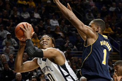 Penn State&#039;s Brandon Taylor, left, looks for a shot past Michigan&#039;s Glenn Robinson III during the first half of the Nittany Lions&#039; upset victory.