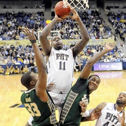 Dante Taylor drives to the basket between South Florida's Kore White and Victor Rudd Wednesday night at Petersen Events Center. Taylor had 12 points -- his first time in double figures in 19 games.