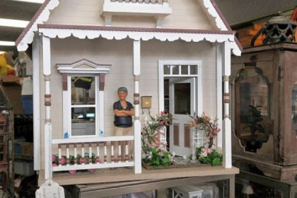 "This miniature called ""Kotton Candy"" at Lynlott Miniatures Dollhouse Junction is electrified. Owner Debbie McManus says the small houses are pieces ""of three-dimensional art."""