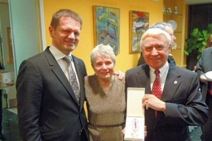 Joseph T. Senko, right, was awarded the Medal of the President of the Slovak Republic. He and his wife, Albina, center, traveled to Washington, D.C., Feb. 1 to receive the medal and met with Slovak ambassador Peter Kmec, left.