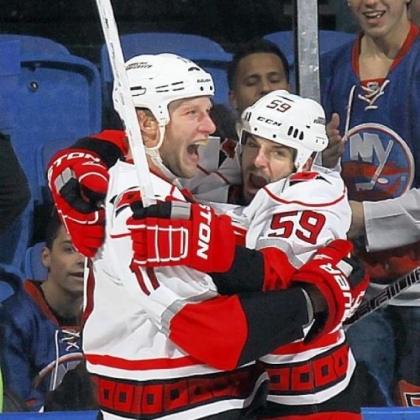 Jordan Staal, left, celebrates the tying goal Sunday against the Islanders in Carolina&#039;s 4-2 victory. Staal will face his former Penguins teammates tonight.