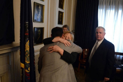 Pittsburgh Mayor Luke Ravenstahl gets a hug from his mother, Cindy, as his father, Judge Robert Ravenstahl looks on.
