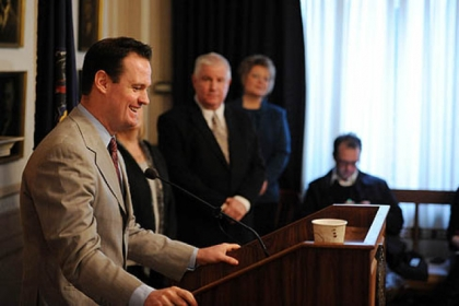 Mayor Luke Ravenstahl smiles during the press conference announcing he will not run for re-election. His parents, Cindy and Judge Robert Ravenstahl, look on.