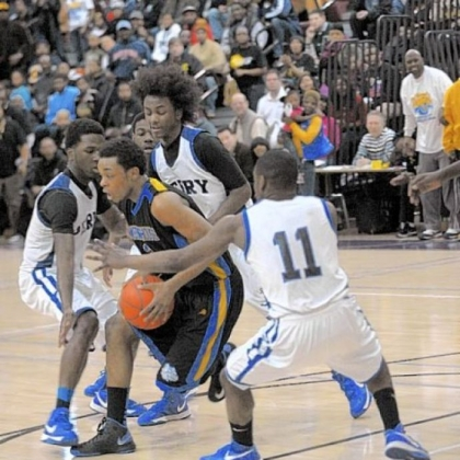 Westinghouse's DaSonte White tries to work his way out of a Perry triple team in Saturday's City League final at Obama High School.