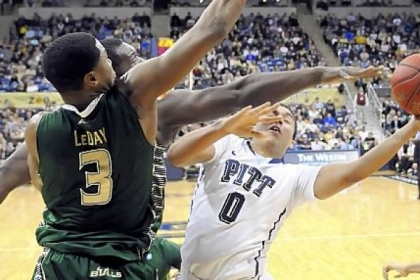 Pitt's James Robinson drives to the net against South Florida's Zach Leday in the first half Wednesday at Petersen Events Center. Coach Jamie Dixon likely will not use the freelance offense his team used against the Bulls much more.