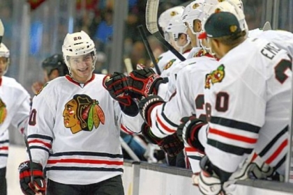 Pine-Richland graduate Brandon Saad of the Chicago Blackhawks is congratulated by teammates after scoring a goal in the first period of a Feb. 5 game in San Jose against the Sharks
