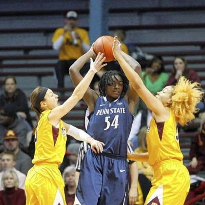 Penn State forward Nikki Greene tries to elude Minnesota guard Shayne Mullaney and forward Micaella Riche.
