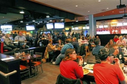 Patrons can eat and watch the Penguins game on big screens at the Sports Theater on the first floor.