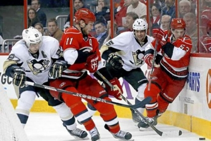 Hurricanes center Jordan Staal fights for the puck last night against Penguins center Sidney Crosby in the second period.