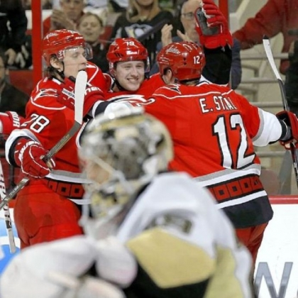 The Hurricanes' Jiri Tlusty, center, celebrates his goal with teammates Alexander Semin, left, and Eric Staal as Penguins goalie Marc-Andre Fleury reacts in the foreground Thursday in Raleigh, N.C. The Penguins lost, 4-1.