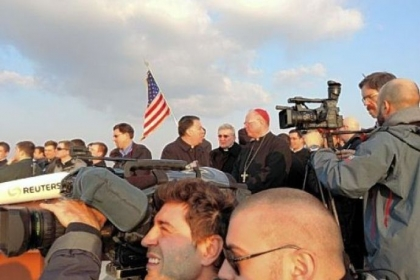 Bishop David Zubik of Pittsburgh, background with sunglasses, was among a crowd of Catholic clergy and news media that stood on the roof of the North American College to watch Pope Benedict XVI's helicopter depart the Vatican.