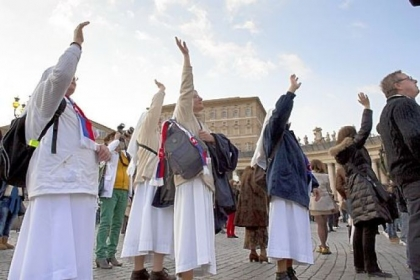 Nuns wave as the helicopter carrying Pope Benedict XVI passes by St Peter's Square on Thursday in Vatican City. Pope Benedict XVI has been the leader of the Catholic Church for eight years and is the first pope to retire since 1415.