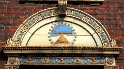 The old Paramount Pictures emblem still stands above the door to the entrance of the former Paramount Film Exchange on Miltenberger Street and the Boulevard of the Allies, Uptown.