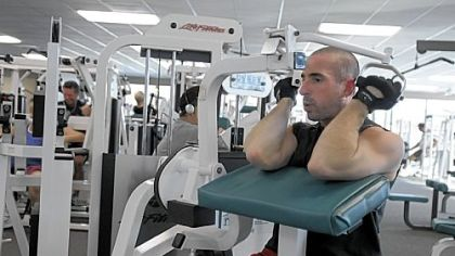 Mark Bennardo of Ross uses the weight machines during a workout at Club Julian, Ross.