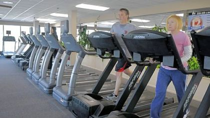 Members of Club Julian work out on the treadmills.