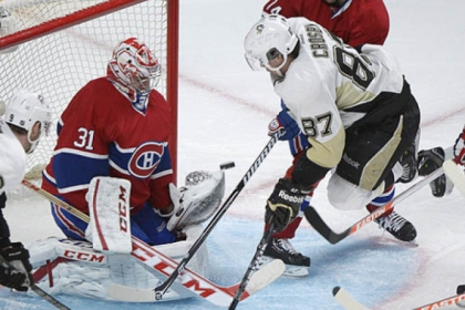 Montreal Canadiens goaltender Carey Price makes a save against the Penguins' Sidney Crosby during the second period.