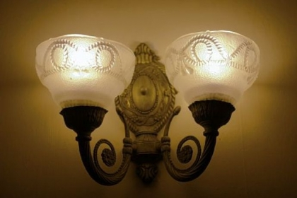 The Victorian-style house has several vintage details, including the light fixtures.