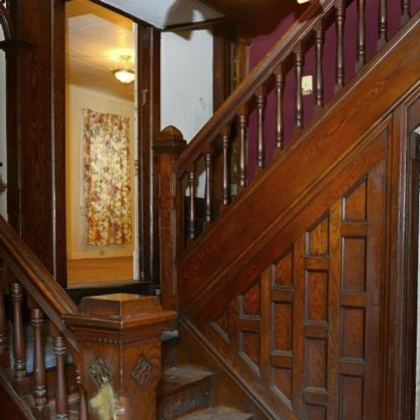 This five-bedroom home in Beaver features original woodwork, as shown on the left, detailed newel posts and bannisters that highlight the staircase.