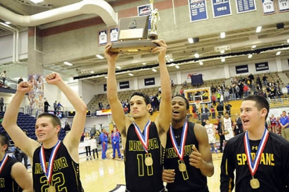 Montour's Devin Wilson holds the trophy with his teammates after defeating Chartiers Valley in the WPIAL class AAA championship Friday night at Palumbo Center.