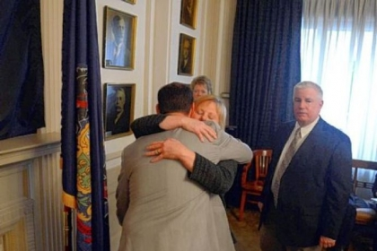 Mayor Luke Ravenstahl hugs his mother, Cindy, and father, Robert, after announcing the end of his re-election bid Friday.