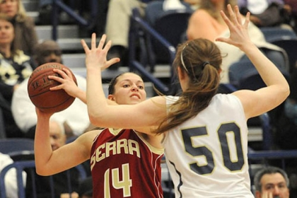 Serra Catholic's Jessica Manfredi looks to pass around Vincentian's Brenna Wise.