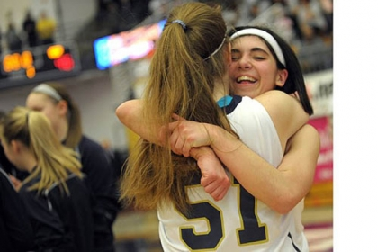 Vincentian teammates celebrate after beating Serra Catholic for the Class A girls title.