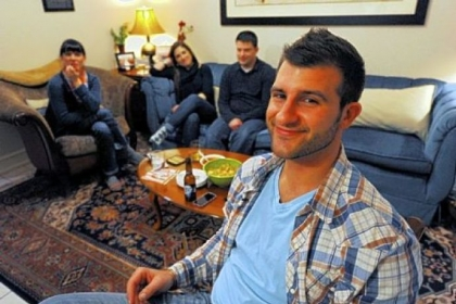 "Lawrenceville's Chase Rogan with his wife, Taylor, left, and Megan and Paul Tarasi in Mr. Rogan's living room waiting for the ninth episode of Spike TV's ""The Joe Schmo Show"" to begin."