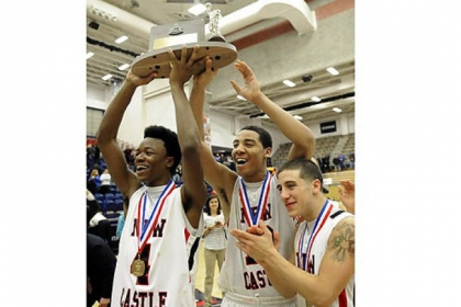New Castle's Antonio Rudolph, Shawn Anderson and Brandon Dominick celebrate their team's win against Hampton in the WPIAL class AAAA championship Saturday.