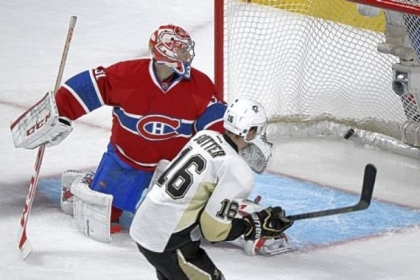 Montreal goaltender Carey Price is scored on by the Penguins' Brandon Sutter in an overtime.