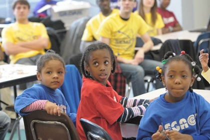 Damiyah Watson, 5, Kamili Wiley, 7, and Aniya Avery, 6, listen at a press conference where WQED Multimedia and The Heinz Endowments representatives announce that they want to collect hundreds of video vignettes showing how black men and boys are making a difference in their communities.