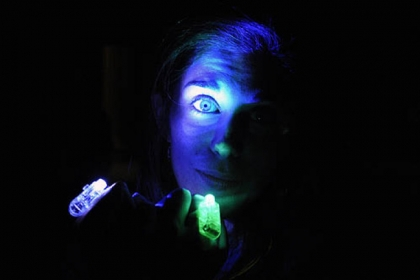 Elizabeth LeDonne of Monaca uses lighted rings to produce a portrait.