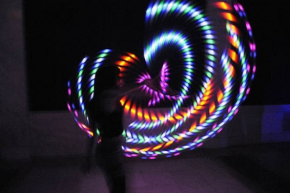 Mallory Sarver of Moon Township makes art using a lighted hula hoop, taken with a long camera exposure.