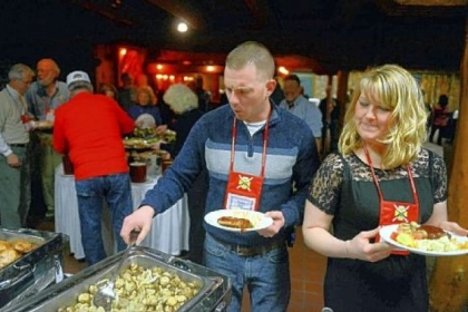 Sean Kluge and Tiffany Barr of Lancaster go through the buffet line during a Wounded Warriors banquet. They served in Afghanistan in the Army in 2011-12 and are now engaged.