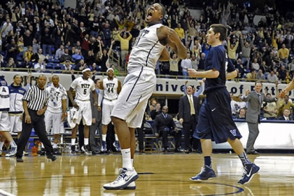 Pitt&#039;s Dante Taylor celebrates after dunking in the final seconds against Villanova in overtime Sunday at the Petersen Events Center.