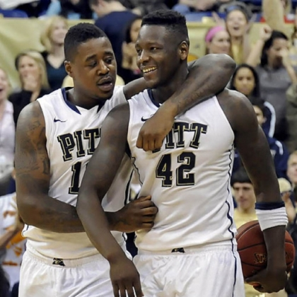 Pitt's Dante Taylor and Talib Zanna celebrate near the end of overtime against Villanova Sunday at the Petersen Events Center.