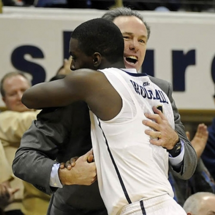 Coach Jamie Dixon hugs senior Tray Woodall as he exits the game in overtime.
