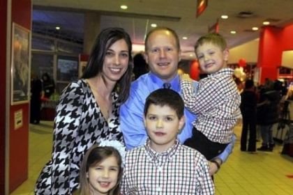 Stephanie and Tim Palochak, holding Carter,3, with in front, Ella, 6, and Blake, 8