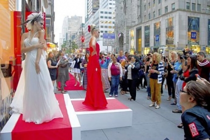 Models pose outside the Elizabeth Arden store on Fifth Avenue during Fashion's Night Out in New York in 2011. The annual shopping event, a  part of New York Fashion Week since 2009, has been discontinued.