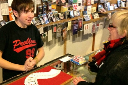 Vince Smith, 18, demonstrates illusions using a deck of cards at the Cuckoo&#039;s Nest on the South Side.