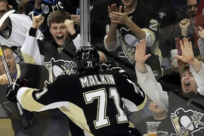 Penguins fans and Evgeni Malkin celebrates his goal against Lightning goaltender Anders Lindback in the third period at Consol Energy Center.