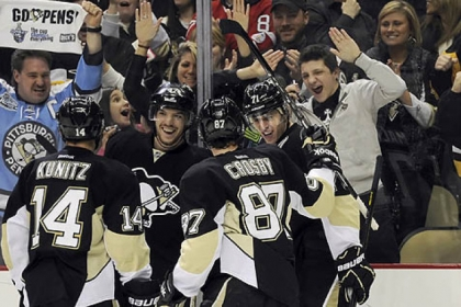 Chris Kunitz, Simon Despres and Sidney Crosby congratulate Evgeni Malkin after his third-period goal.