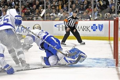 Evgeni Malkin scores the tying against Lightning goaltender Anders Lindback in the third period Monday at Consol Energy Center.